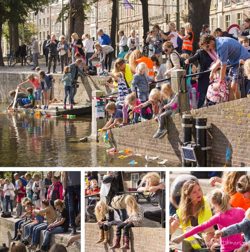 Kinderen laten hun bootjes te water bij initiatief van Liesje Doet, evenement fotografie Sandra Stokmans
