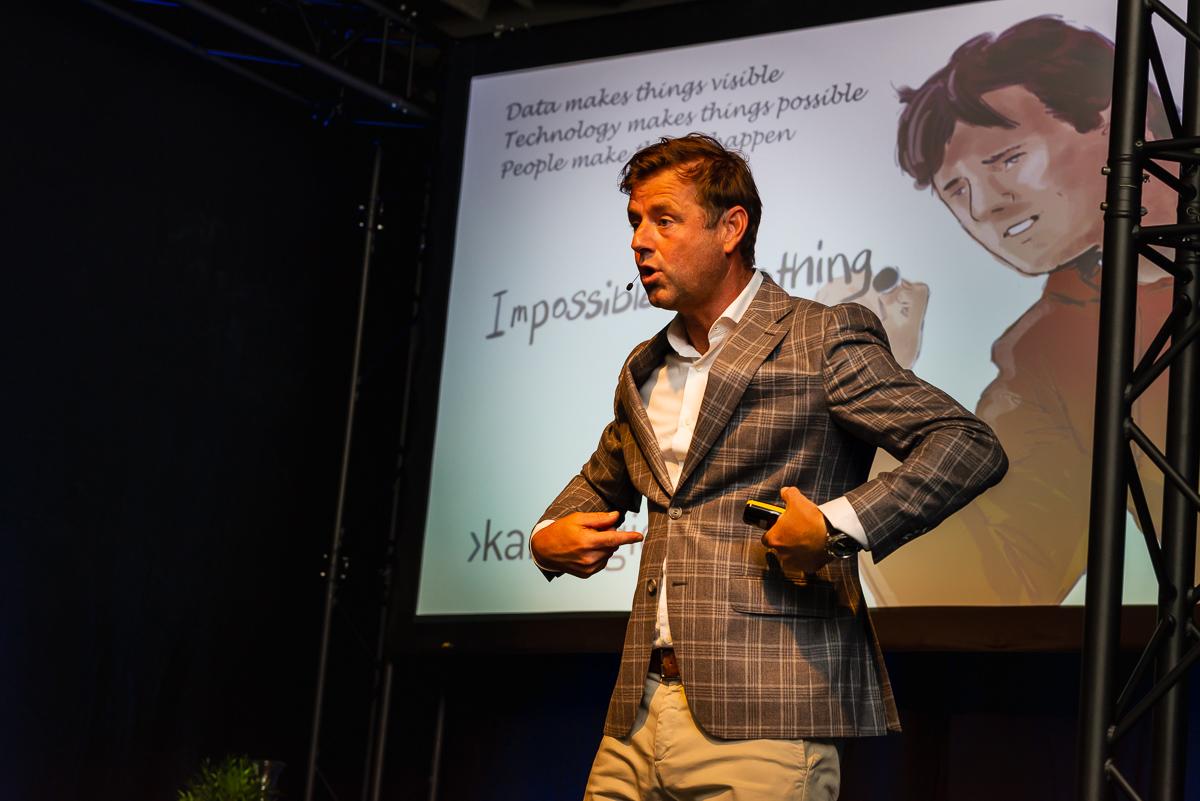 Presentatie van Marc Lammers over topsport en het bedrijfsleven.