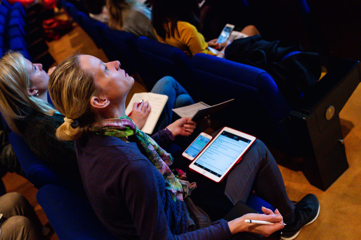 Detail of participants taking notes during the EWPN Conference, with event photographer Sandra Stokmans